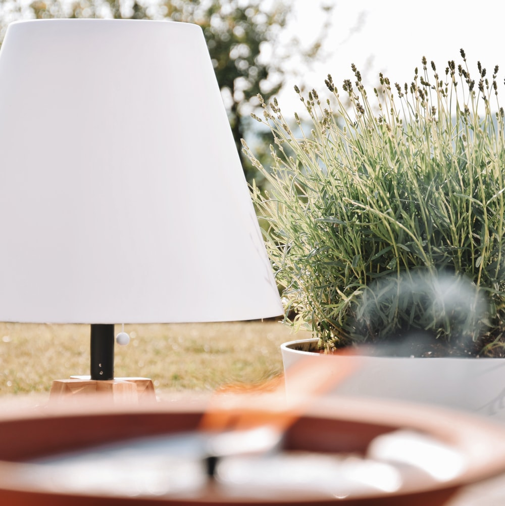 white and black table lamp on brown wooden table