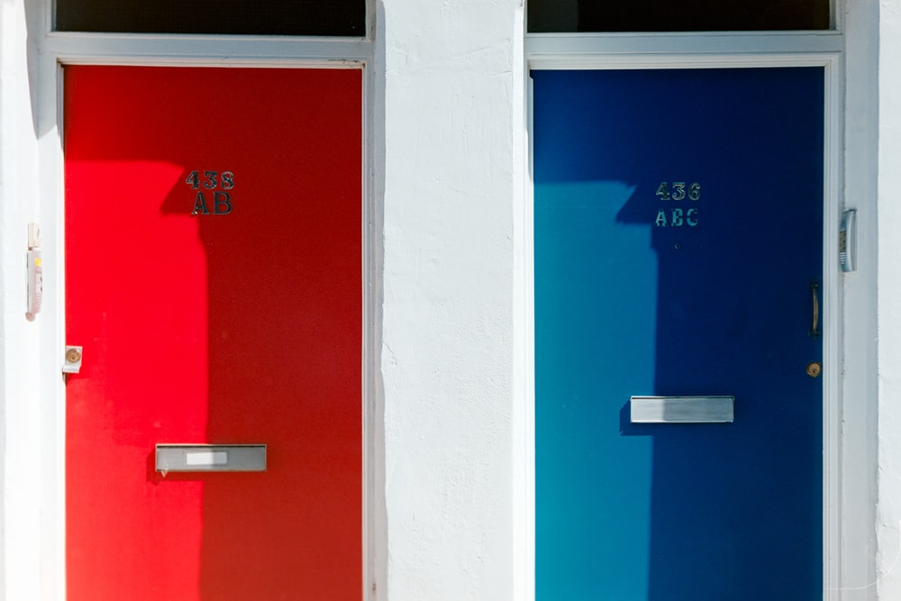 red and blue door with number