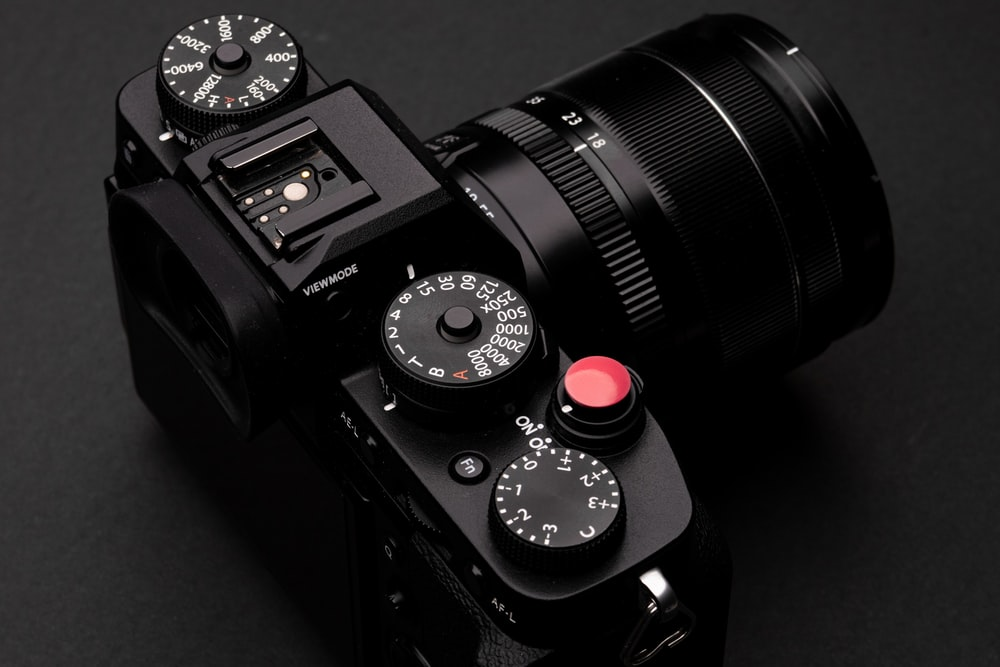 black nikon dslr camera with lens