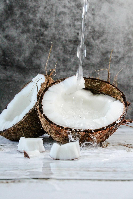 white round cake with white cream on brown wooden round tray