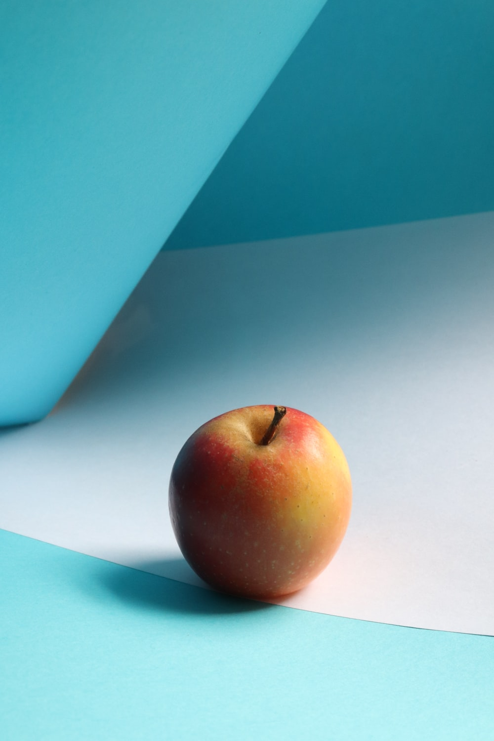 red apple fruit on white table
