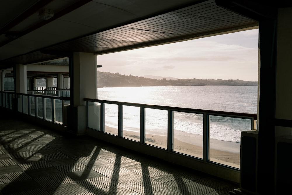 white wooden railings near sea during daytime