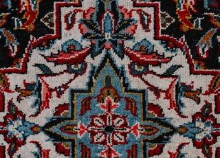 red white and black floral textile