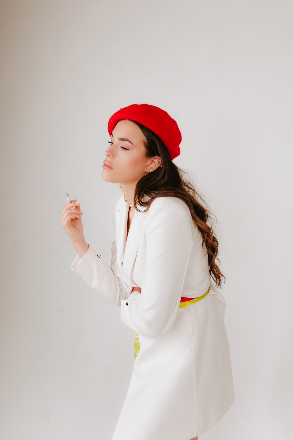 woman in white long sleeve shirt wearing red hat