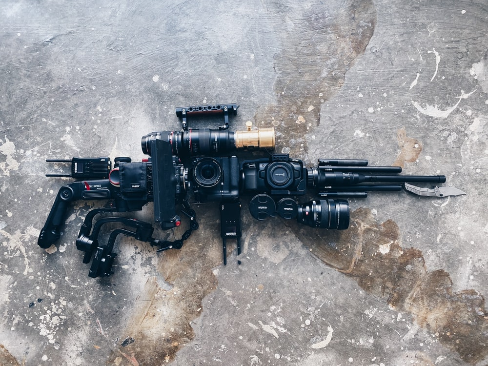 black and gray rifle on gray concrete floor