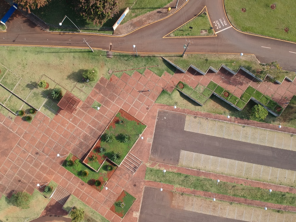 aerial view of green trees and brown brick floor