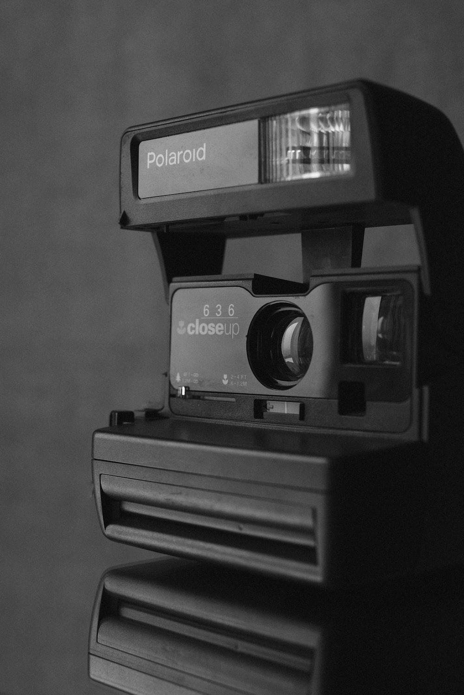 grayscale photo of polaroid instant camera