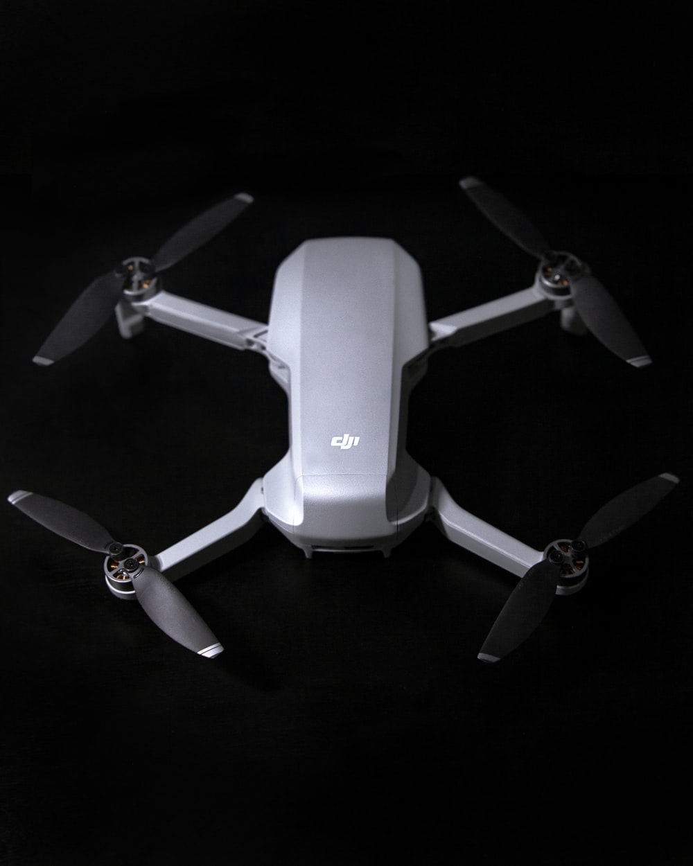 white and gray quadcopter drone