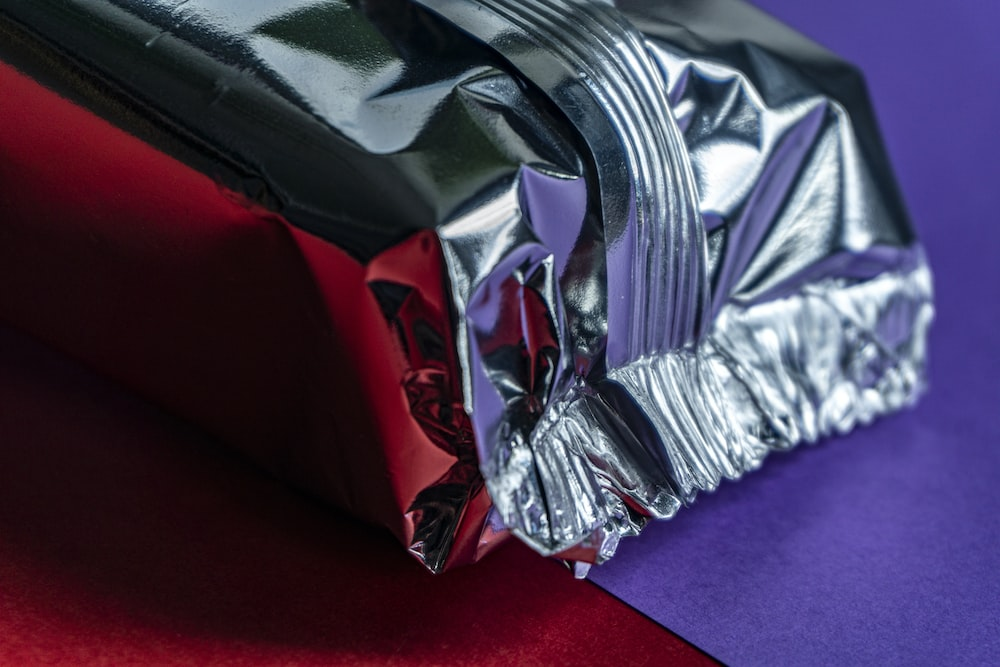 silver foil on red textile