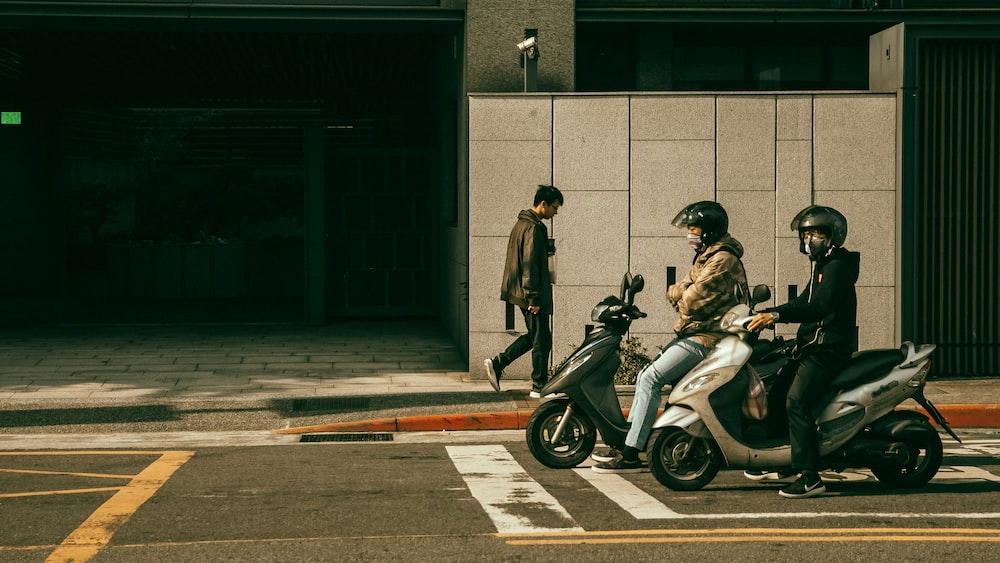 man in black jacket riding on black motorcycle