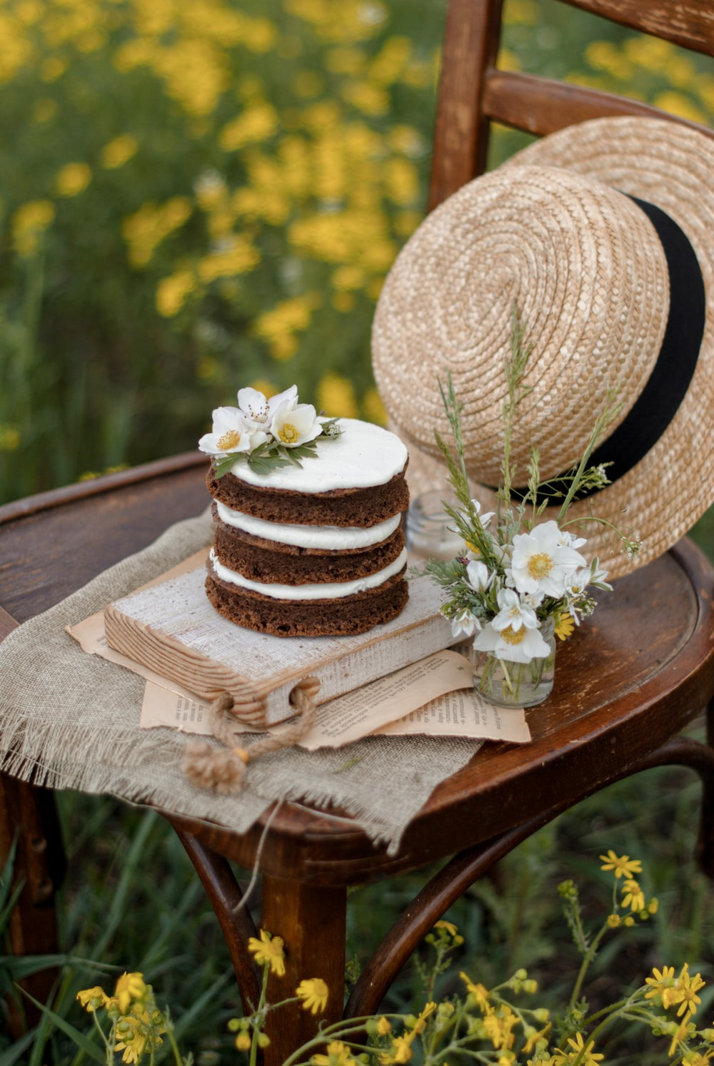 white and brown round hat on brown wooden table