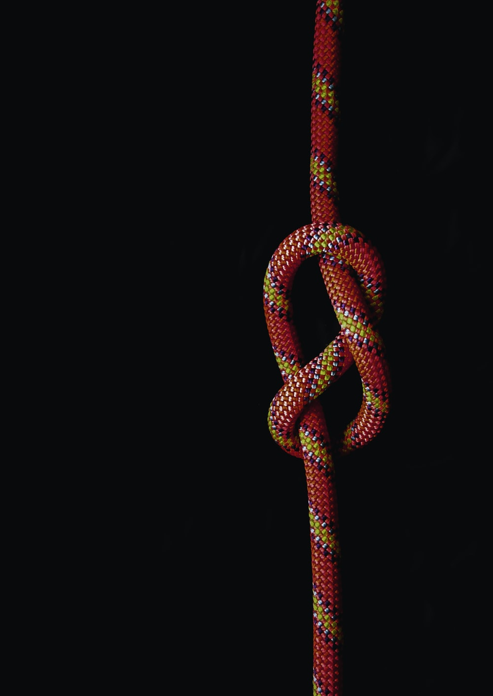 white and red rope on black background