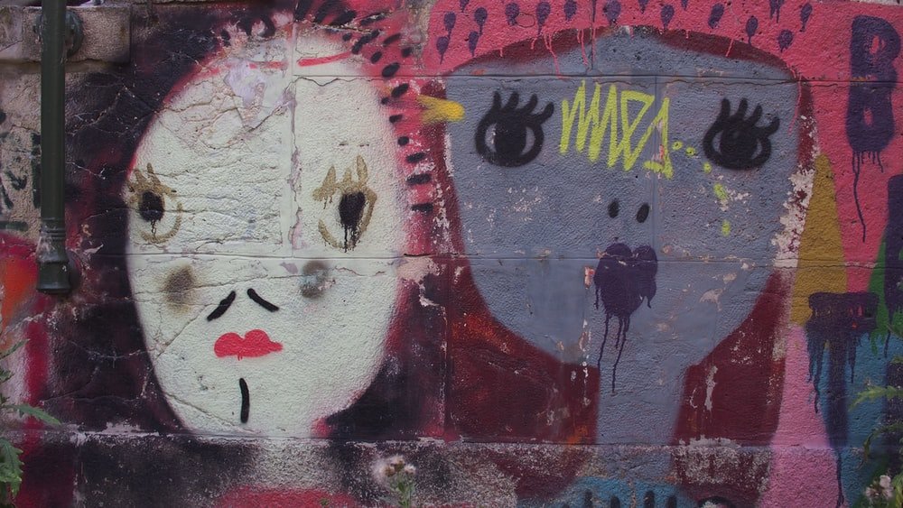 red and white graffiti on wall