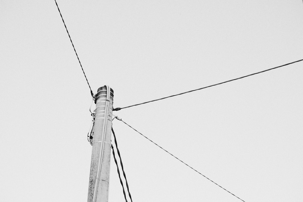 low angle view of electric post