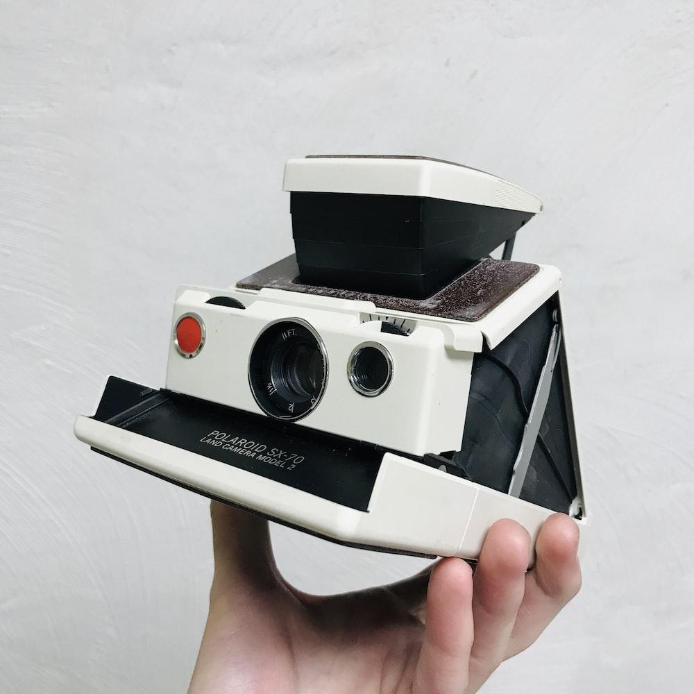 white polaroid one step camera
