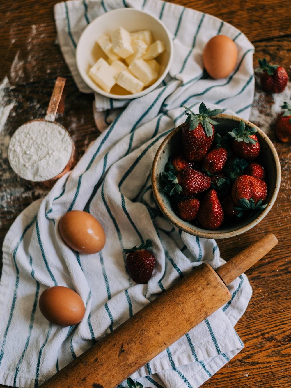 strawberries and blueberries on white ceramic bowl