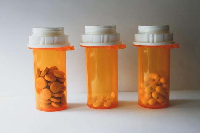 orange and white plastic medicine bottle