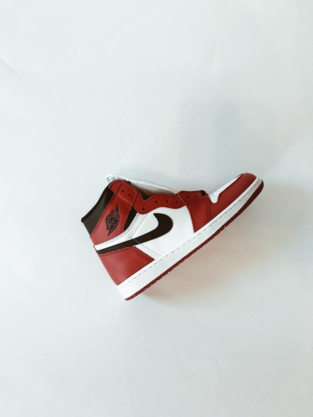 red and white nike shoe
