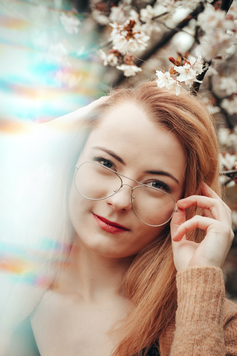 woman wearing silver framed eyeglasses