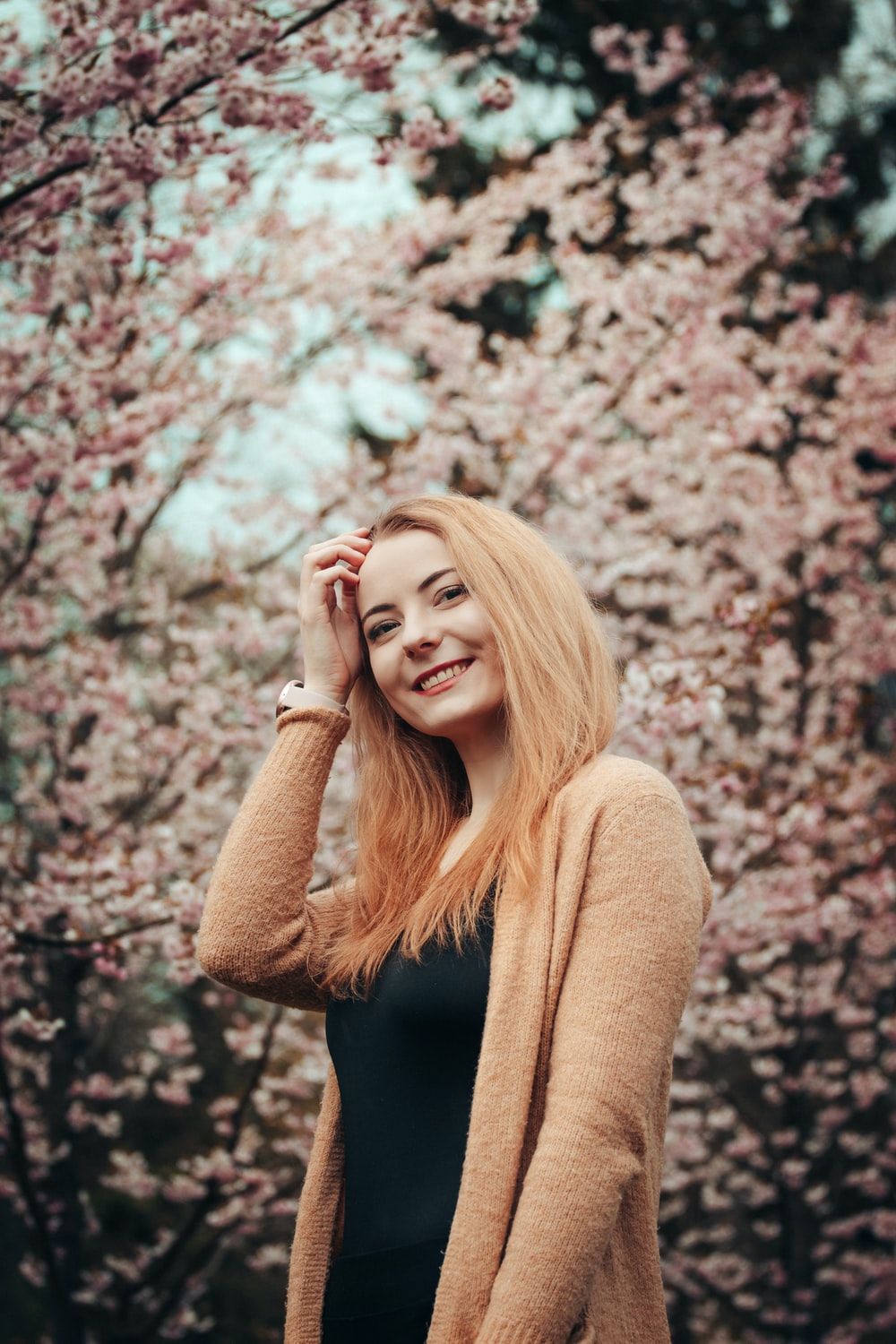 woman in brown sweater smiling