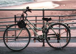 black city bike on beach during daytime