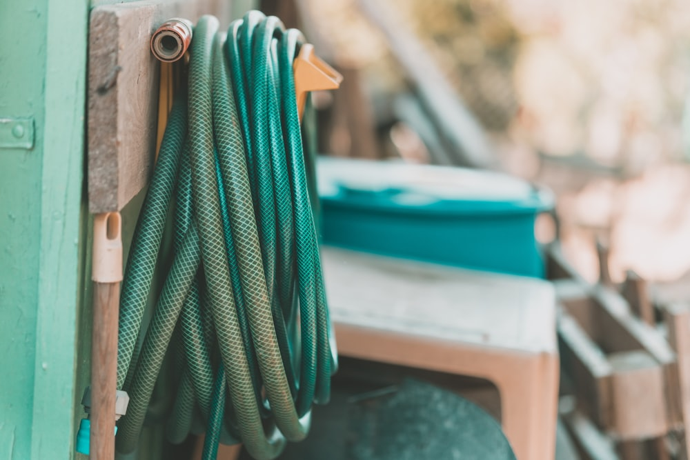green rope on blue and white plastic container