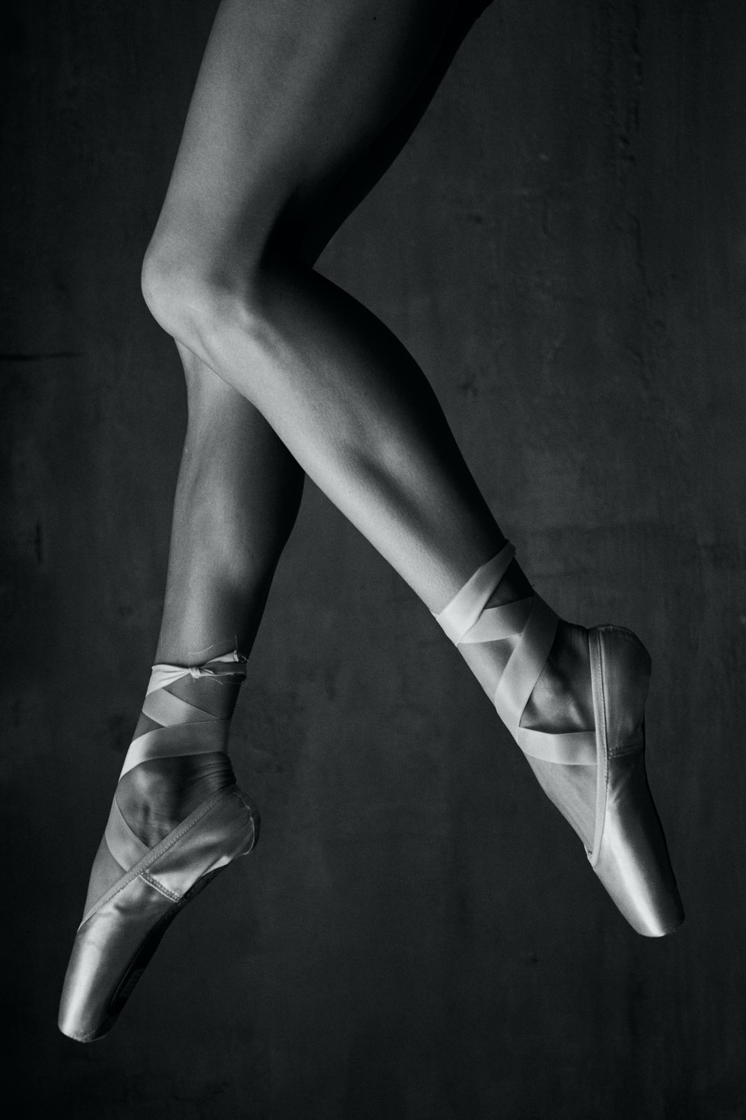 Studio photoshoot with pointe shoes and big window. Photographied by Anton Titov