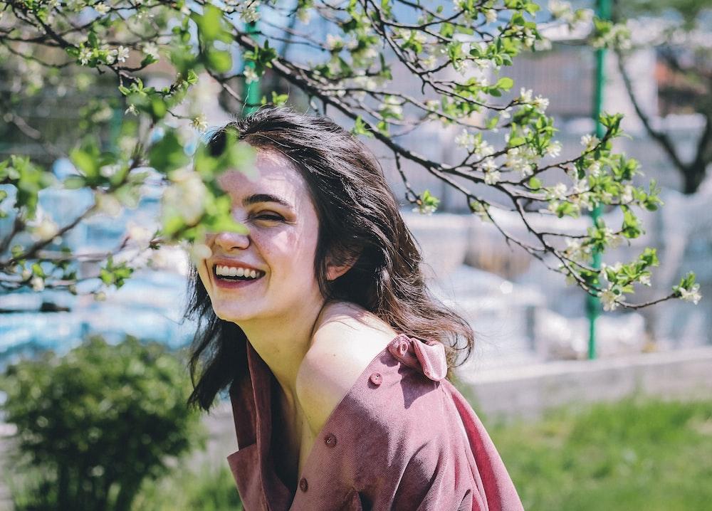 woman in pink coat smiling