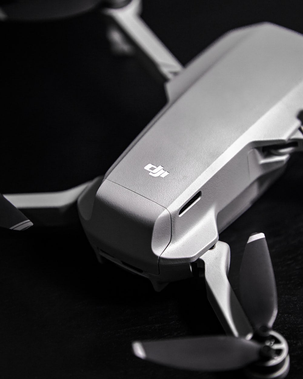 gray and white stapler on black wooden table