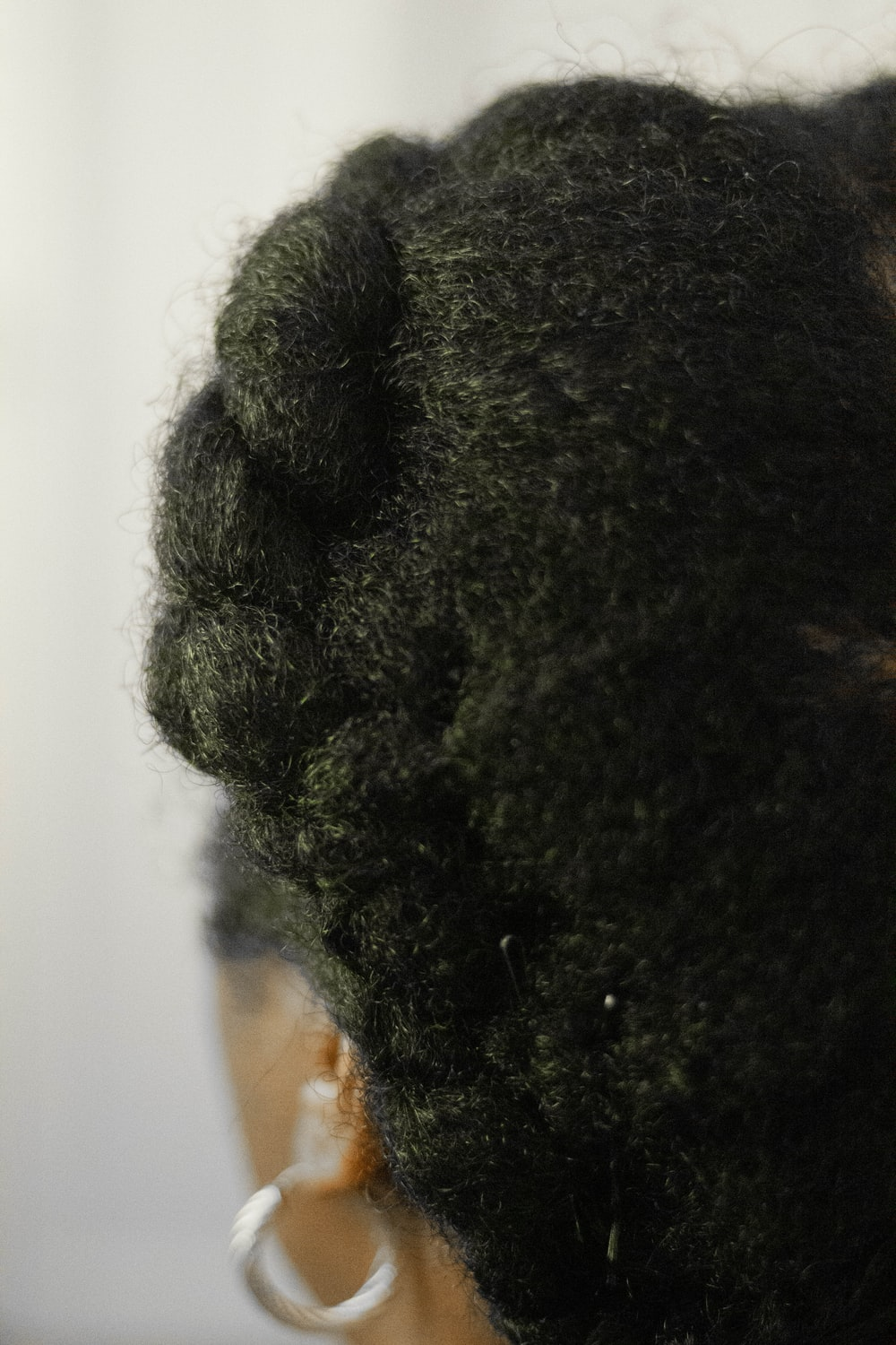 person with black curly hair