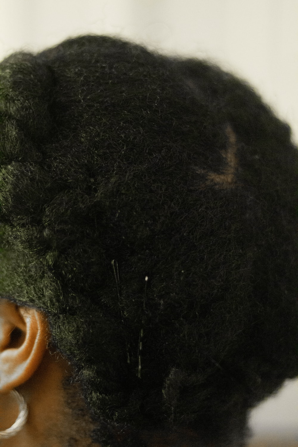 persons black curly hair