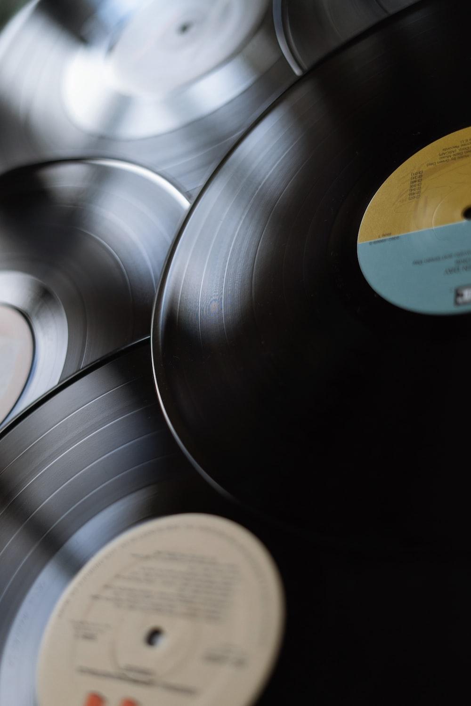 black vinyl record on silver round plate