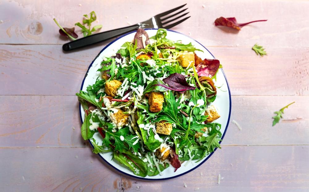 vegetable salad on blue ceramic plate