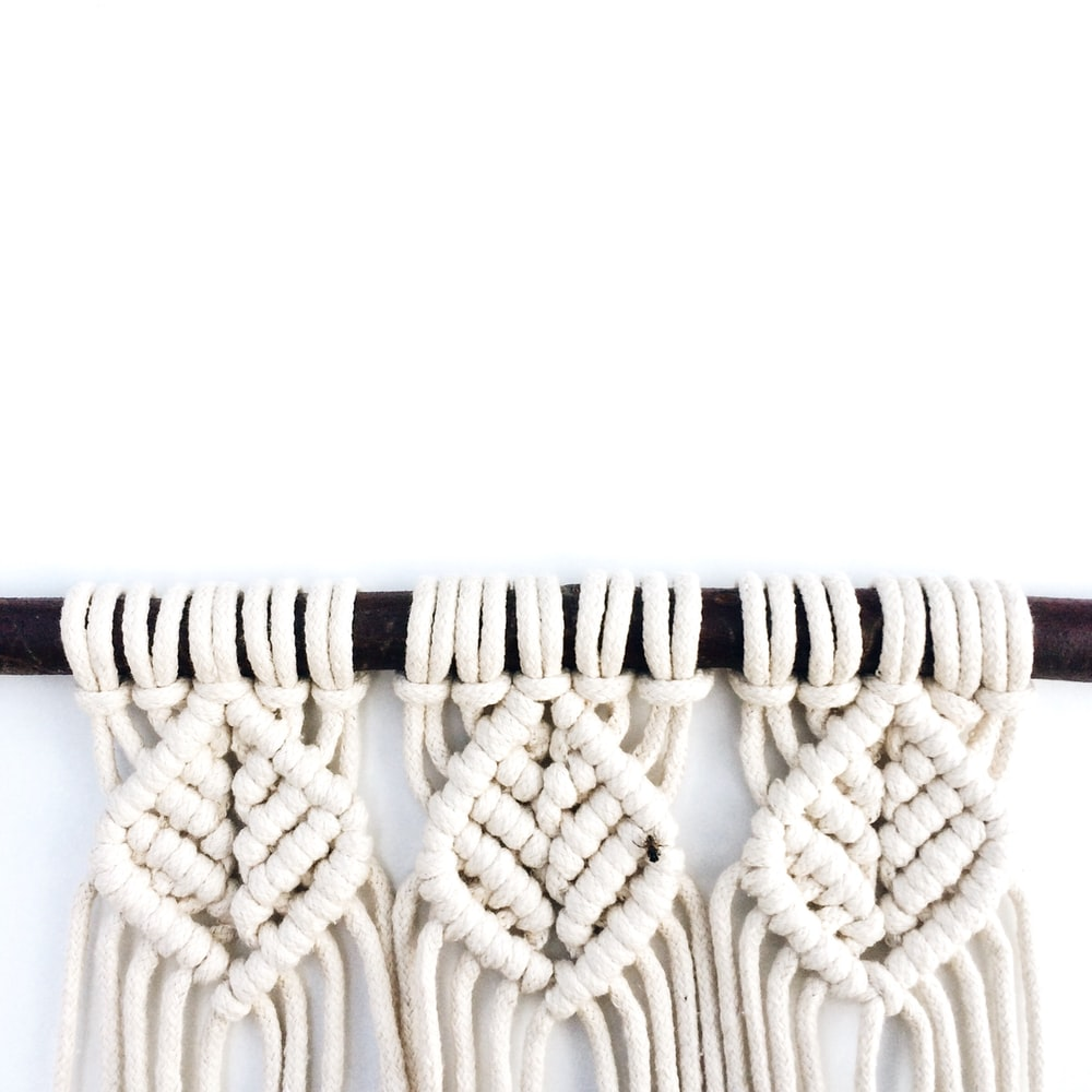 brown and black rope on white background