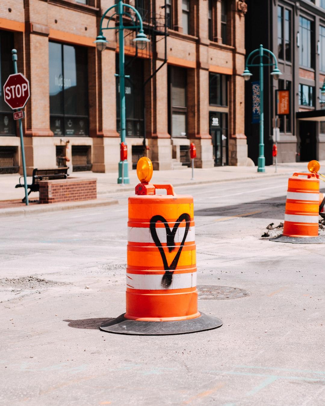 A graffiti heart left on an orange cone, in Milwaukee's Third Ward.