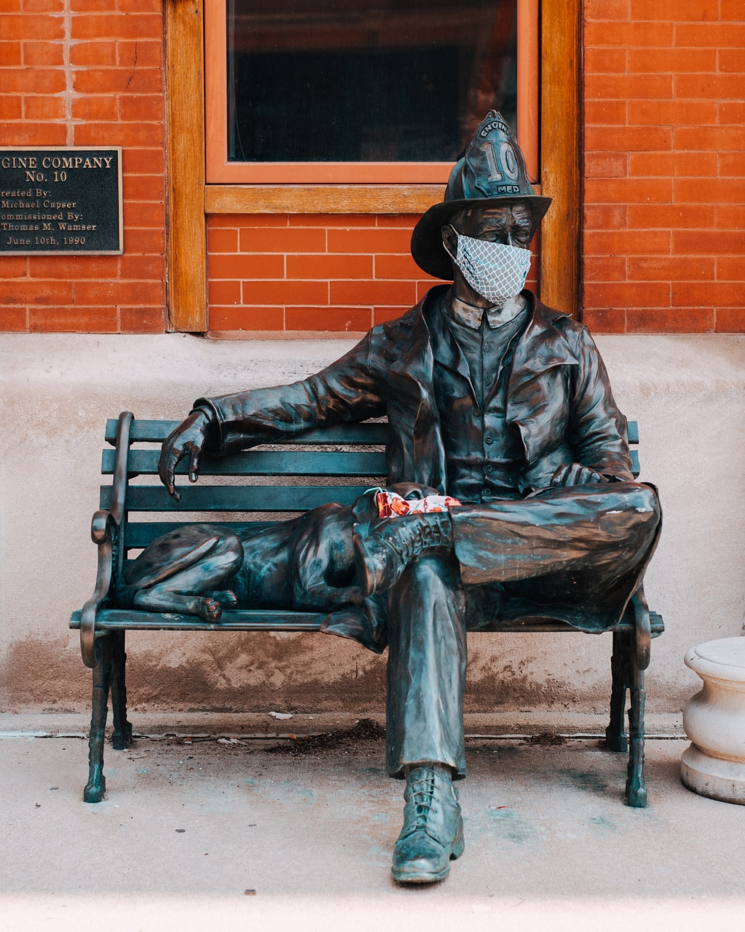 Masks were left on a statue of a fireman and his dog in Milwaukee's Third Ward. These are amongst several displays of solidarity during Covid-19.