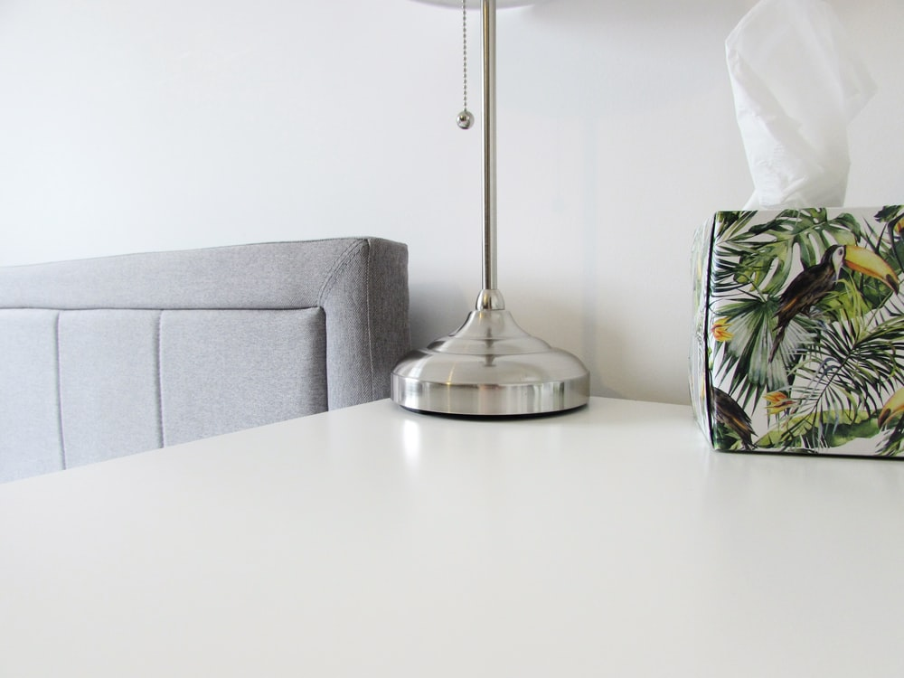 stainless steel table lamp on white table