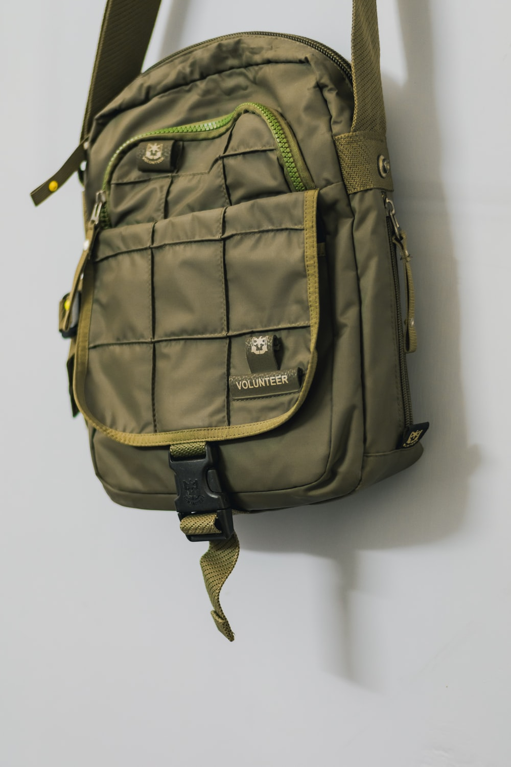 green backpack on white table