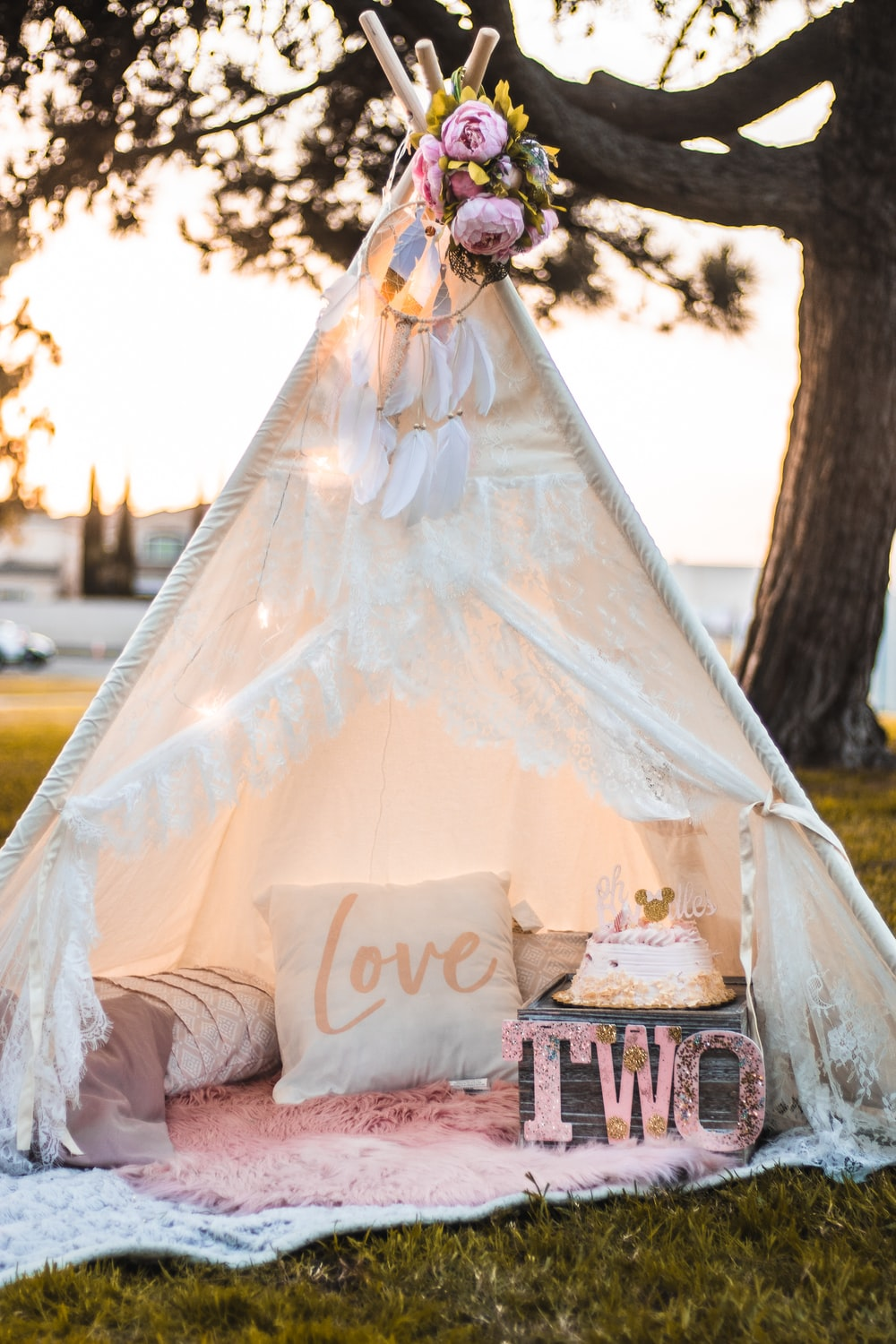 woman in white wedding gown standing beside brown wooden table