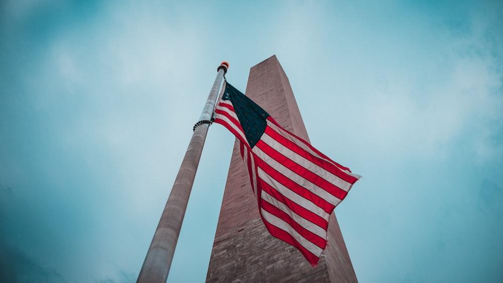 us a flag on brown pole