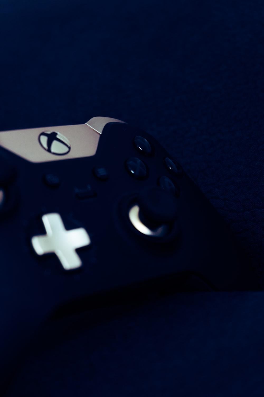 black game controller on black textile