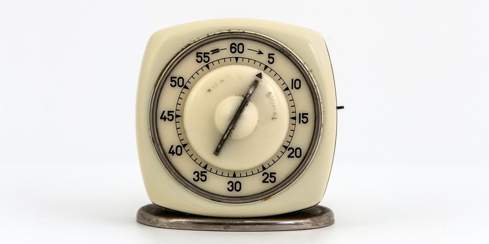 yellow and silver analog desk clock