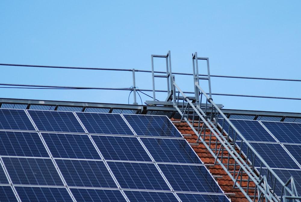 solar panels on gray metal frame under blue sky during daytime