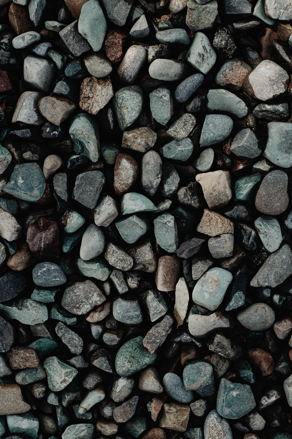 brown and black stones on red surface