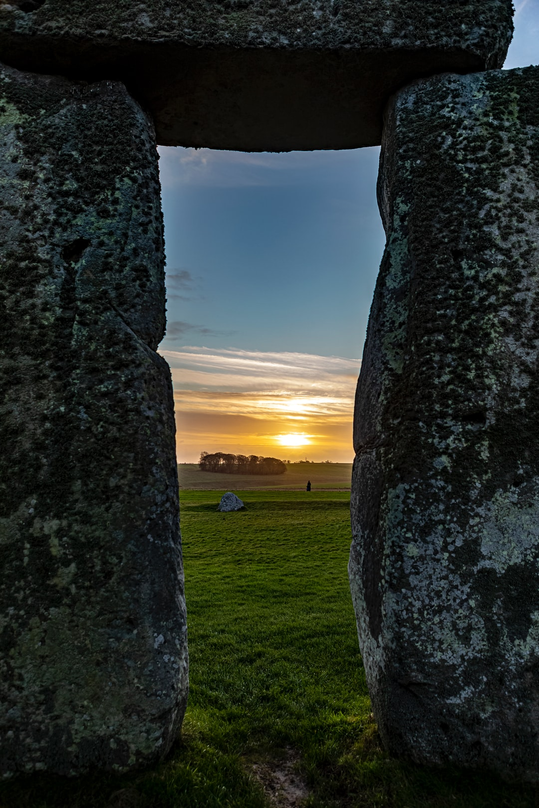 Prehistoric ritual site of Stonehenge with monliths - large stone slabs in rural England, UK. February 2020. Sunrise time.