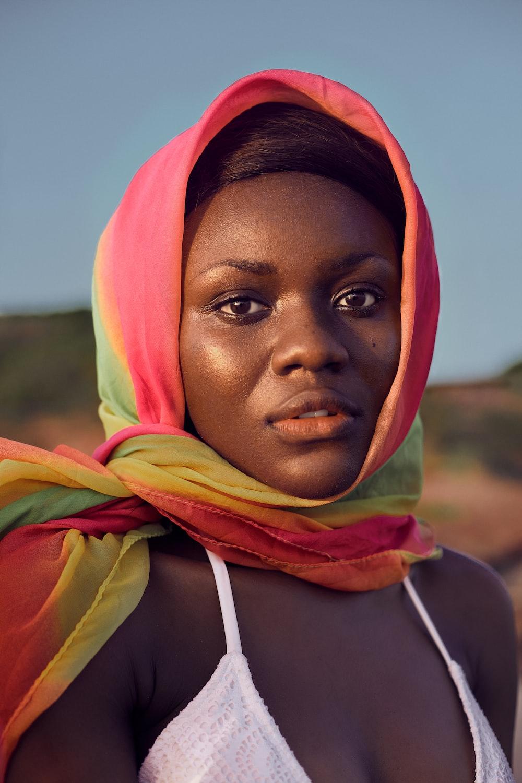 woman in yellow and orange hijab