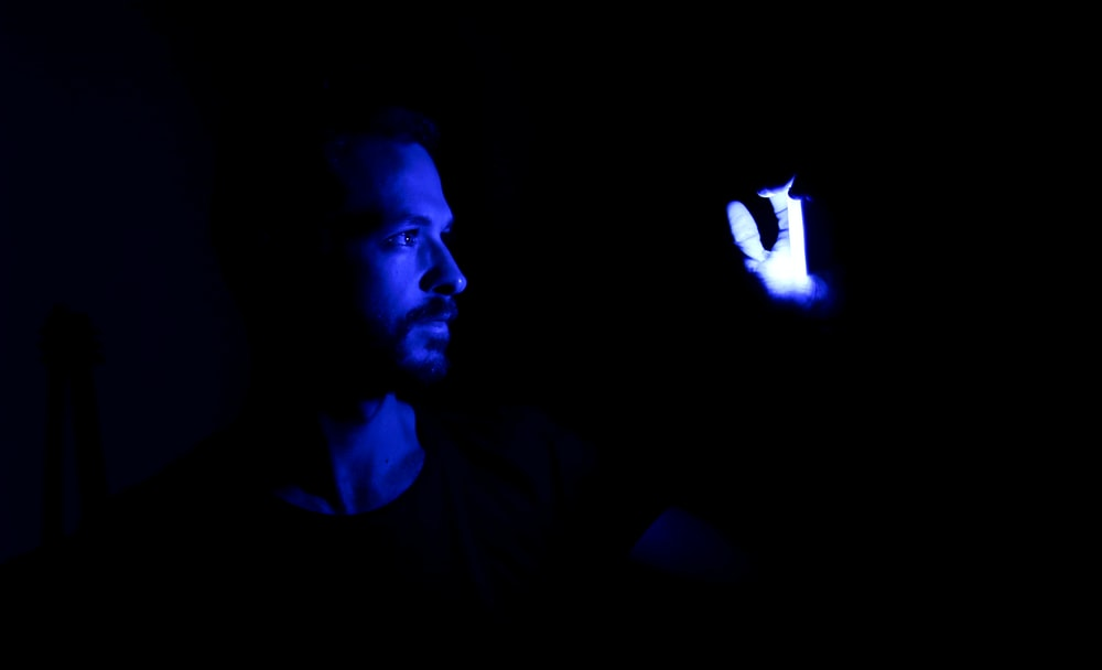 man in black shirt with blue light