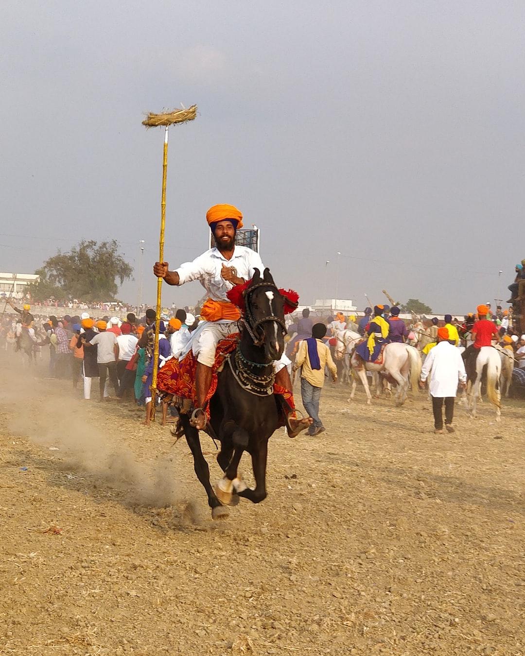 Nihang rider on a horse at hola mohala (holi) festival in Hazursahib, Nanded.