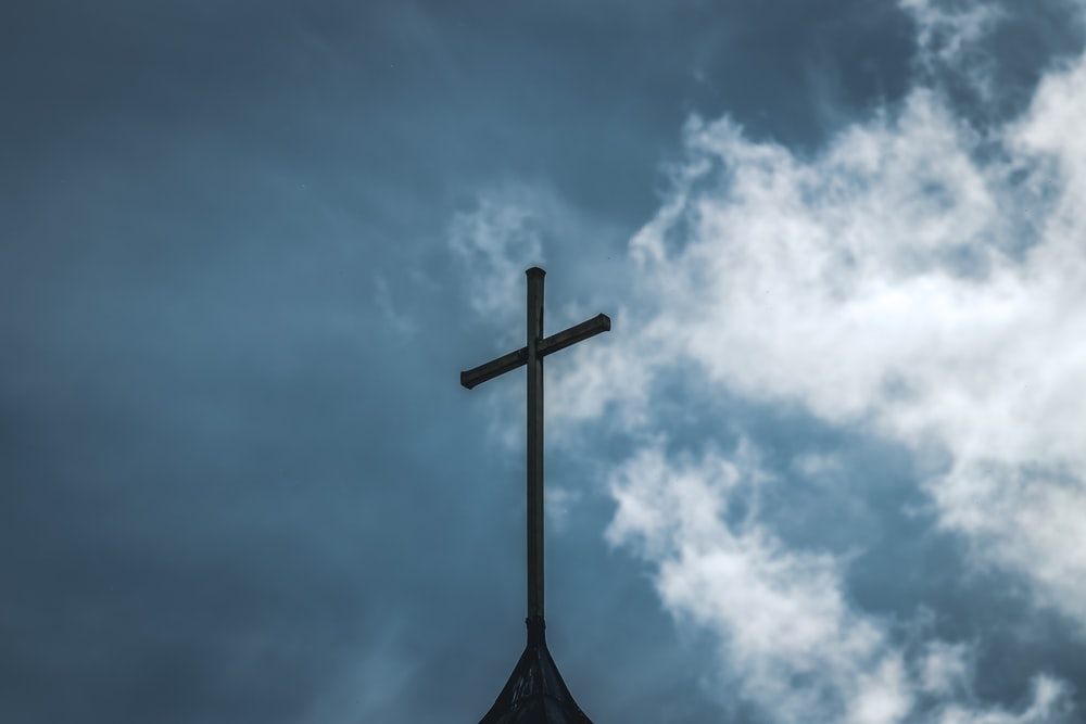 brown wooden cross under blue sky during daytime