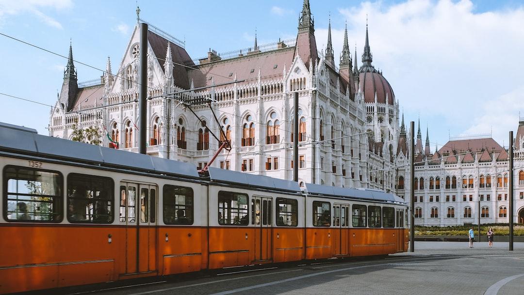 Beautiful old school yellow tram on Budapest Streets near Hungarian Parliament